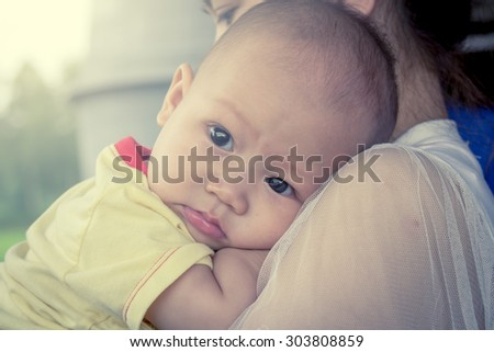 Cute little boy on hug of mother in sweet soft color filter - stock photo