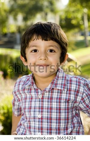 Cute little boy playing outside - stock photo