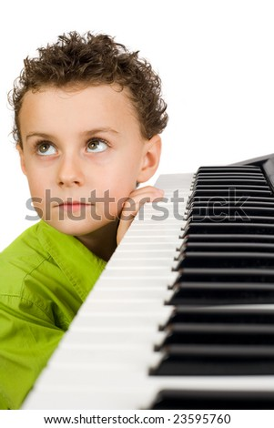 Cute little boy playing synthesizer or piano, isolated on white background - stock photo