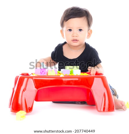 Cute Little Boy Playing Toy Isolated on the White Background. - stock photo