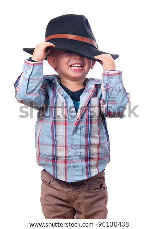 Cute little boy playing with cowboy hat isolated on white. - stock photo