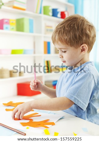 Cute little boy playing with paper chain  - stock photo