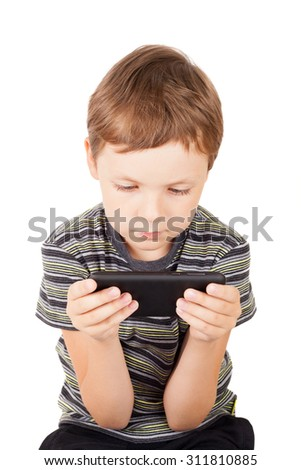 cute little boy playing with the PC tablet