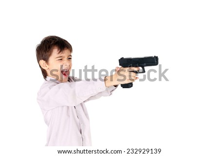 cute little boy playing with the pistol - stock photo