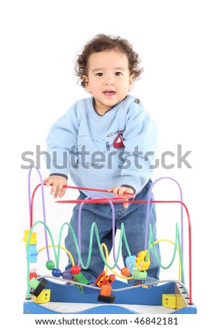 Cute little boy playing with wooden beads toy