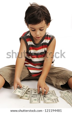 Cute little boy plays with money - stock photo