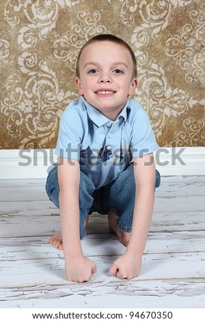 Cute little boy posing for camera