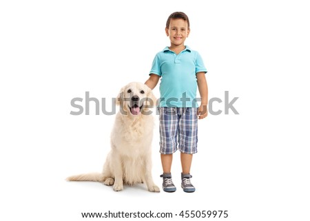 Cute little boy posing together with a young Labrador retriever dog isolated on a white background - stock photo
