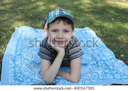 cute little boy relaxing in a park - stock photo