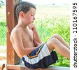 Cute little boy resting after playing hard on a hot day. - stock photo