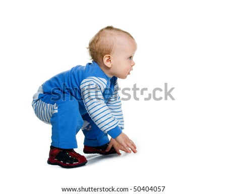 Cute little boy sit on white background - stock photo