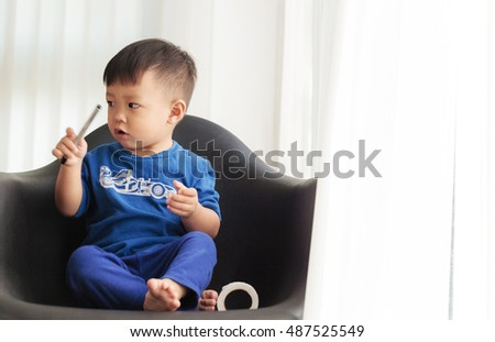 Cute Little Boy siting on the chair