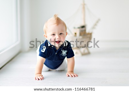 cute little boy sitting on the floor, a marine style