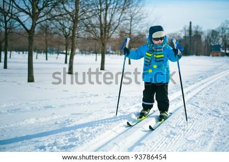 Cute little boy skiing on cross - stock photo