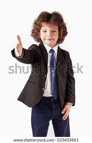 Cute little boy stretched out his hand in greeting. White background.