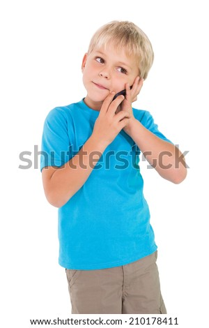 Cute little boy talking on smartphone on white background - stock photo