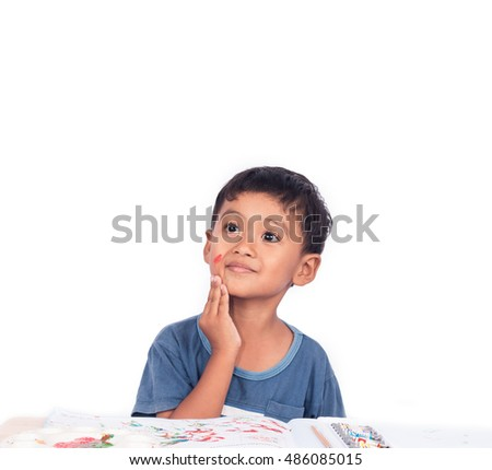 Cute little boy thinking while doing homework