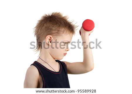 cute little boy tired while training with the dumbbells - stock photo