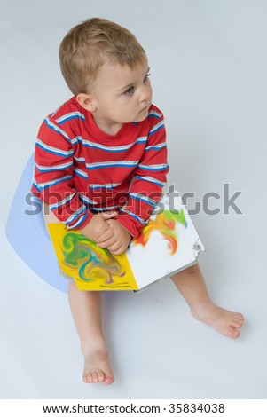 cute, little boy while potty training - stock photo
