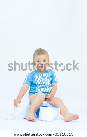 cute, little boy while potty training, on white - stock photo