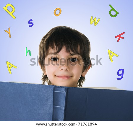 Cute little boy with a big book on white background - stock photo