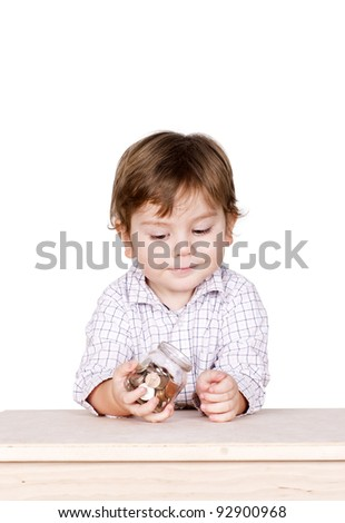 Cute little boy with a bottle in his hands with some coins in it. Isolated on white. - stock photo