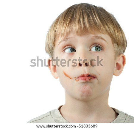 cute little boy with a chocolate on the face