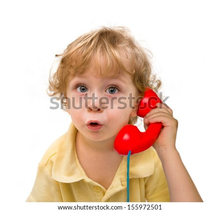 Cute little boy with a red phone   - stock photo