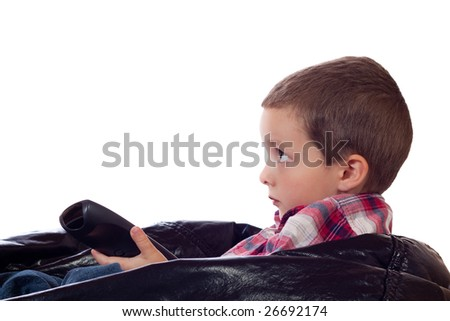 Cute little boy with a remote control - stock photo