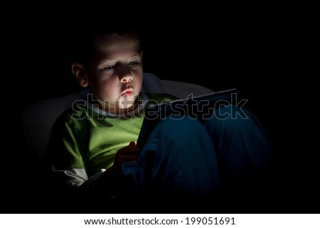 Cute little boy with a tablet pc  - stock photo