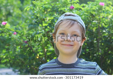 cute little boy with an ice cream outdoors - stock photo