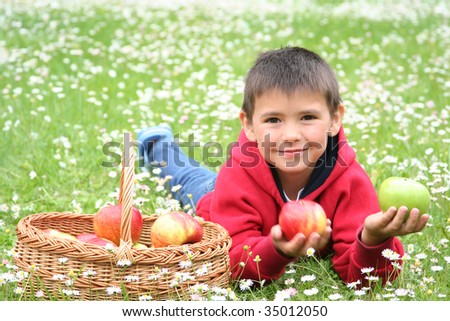 cute little boy with basket of apples - stock photo