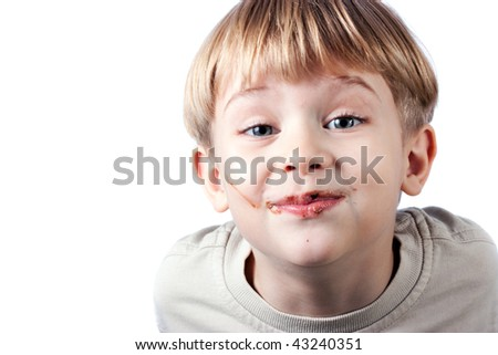 cute little boy with chocolate on the face isolated over white - stock photo