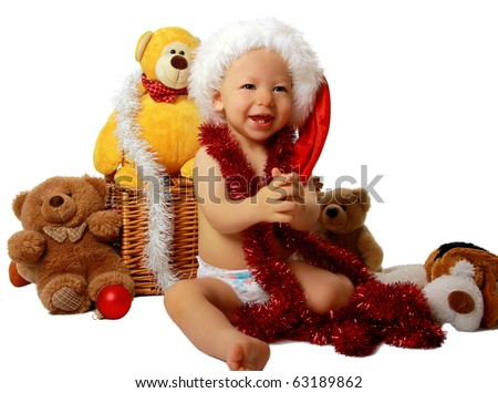 cute little boy with christmas decorations isolated on white