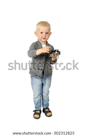 Cute little boy with computer item in hands isolated on white background - stock photo