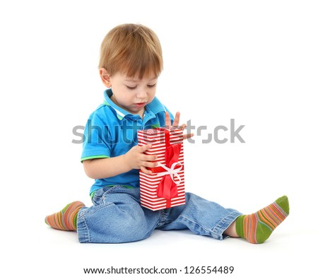 cute little boy with girts, isolated on white - stock photo