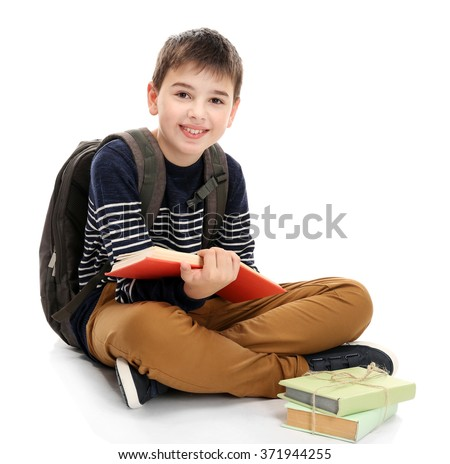 Cute little boy with grey backpack reading books, isolated on white