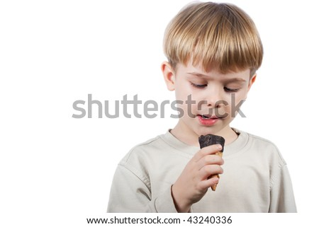 cute little boy with ice-cream in the hand isolated over white