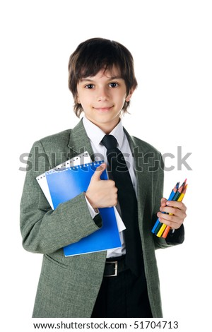 Cute little boy with notebooks and pencils on white background - stock photo