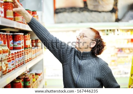 Cute little boy with shopping cart at market - stock photo