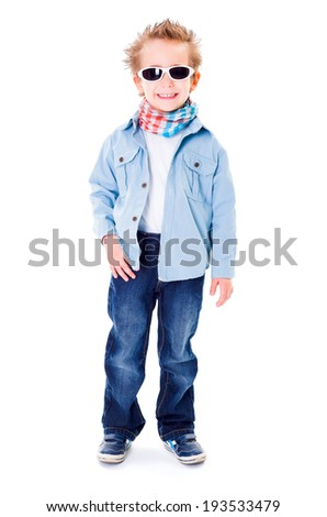 Cute little boy with sunglasses posing at studio - stock photo