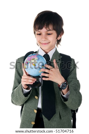 Cute little boy with terrestrial globe on white background - stock photo