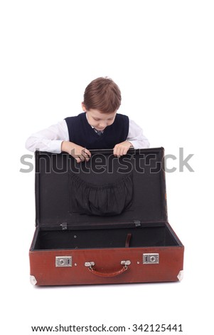 cute little boy with the big suitcase - stock photo