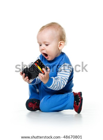 Cute little boy with the car toy on white background - stock photo