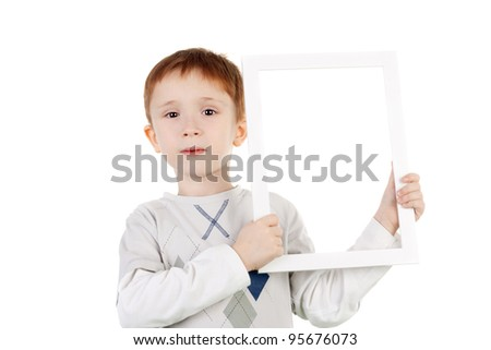 cute little boy with the photo frame - stock photo