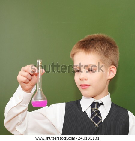 cute little boy with the pink chemical agent tubes