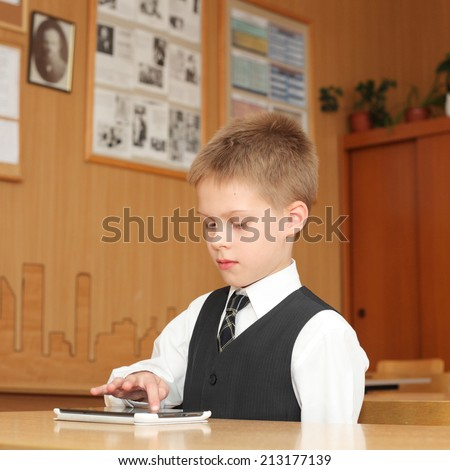 cute little boy with the tablet pc - stock photo