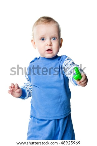 Cute little boy with the toy on white background - stock photo