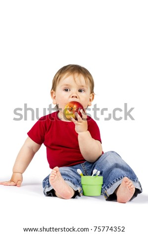 Cute little boy with toothbrushes and apple, dental care concept. Isolated on white. - stock photo
