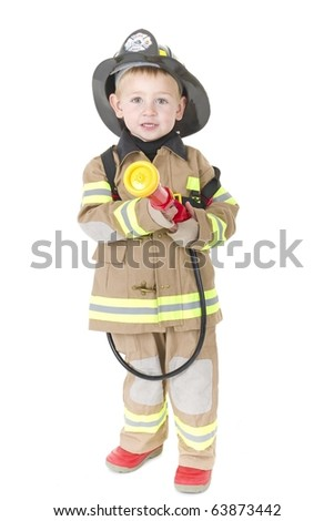 Cute little boys dressed in fire fighting uniforms - stock photo